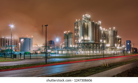 Night scene with Illuminated petrochemical production plant, Antwerp, Belgium.