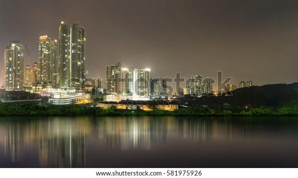 Night scene of Kuala Lumpur city reflection on the lake