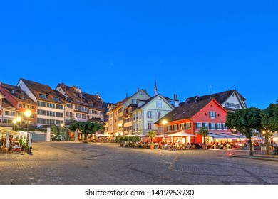 Night scene of Landsgemeinde square opening towards the lake in Zug, Switzerland