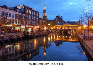 Night scene in Leiden, The Netherlands with the Korenbeursbrug bridge and the City Hall (Stadhuis).
