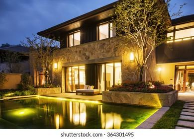 night scene of modern building near pond at night