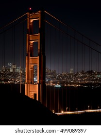 Night scene (nightscape) of  the Golden Gate Bridge and the city of San Francisco.  Vantage point is from the Marin Headlands.