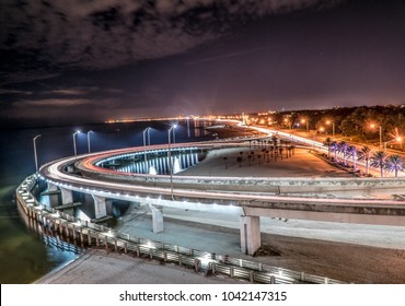 Night scene overlooking the Biloxi area of Highway 90 with the beach and traffic