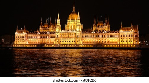 Night scene of Parliament building and Danube river in Budapest from Buda embankment