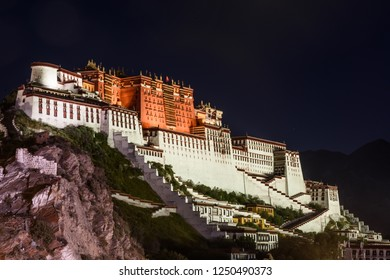 Night scene of the Potala Palace  from the former Lhasa West Gate in Lhasa, Tibet, China. It is now a museum and World Heritage Site.