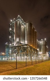 Night scene with silos on Illuminated petrochemical production plant, Antwerp, Belgium.