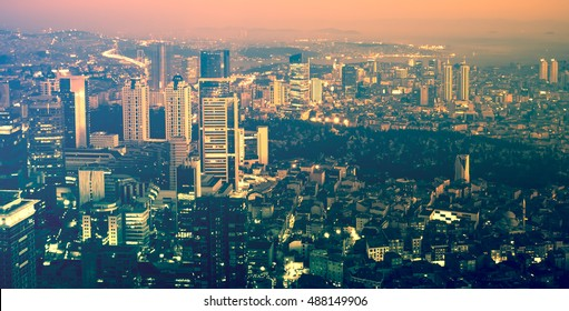 Night scene with skyscrapers in megacity. Modern city architecture, banner in urban style. Business background for your corporation concept. Night buildings on skyline in colour of trend, top view.
