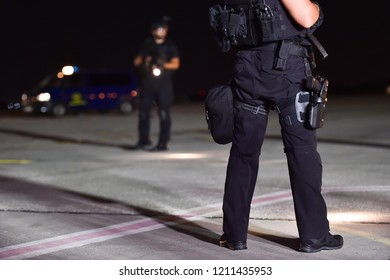 Night scene with special forces showing their skills in a simulated hostage rescue drill