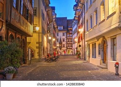 Night scene of a street in old town of Zug, Switzerland.