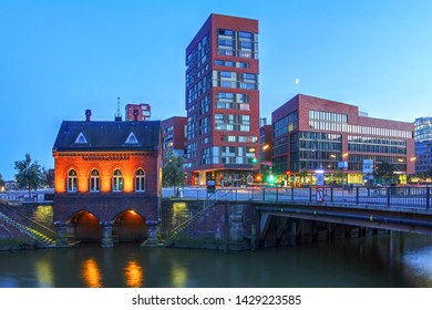 Night scene in the Warehouse District (Speicherstadt) of Hamburg, Germany, featuring Fleetschlosschen, one of the first buildings of the district guarding the St. Anna Bridge.