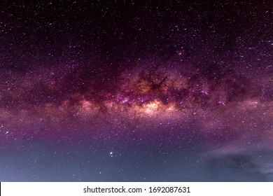 Night scenery with colorful and light yellow Milky Way Full of stars in the sky in summer Beautiful universe Background of space