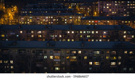The night scenery of five-story houses, the lights of windows in the night dusk, can be used as either a background or a pattern