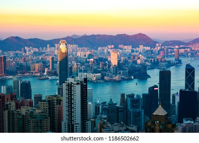 Night scenery of Hong Kong viewed from top of Victoria Peak with city skyline of crowded skyscrapers by Victoria Harbour & Kowloon area across seaport