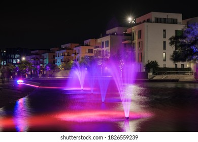 Night scenery of outdoor colorful illuminated lighting on canal for Festival of Light at Green Center Essen in Essen, Germany.