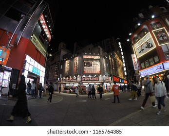 Night scenery in Shinjuku district where people are roaming around the place to chill out during Spring 2018
