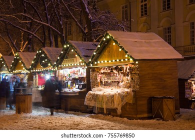 Night scenery with street decorations on the Christmas fair, Market Square, Lviv, Ukraine. Holiday concept.