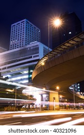 Night scenes of skyscraper with cars motion blurred light in Hong Kong.