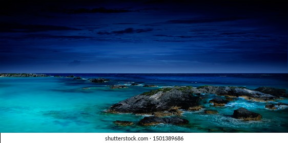 night sea, the ocean as a natural background Magnificent views of the ocean and northern lights with rocks and stones. Beautiful sea water plays with colors and light.Moonlight