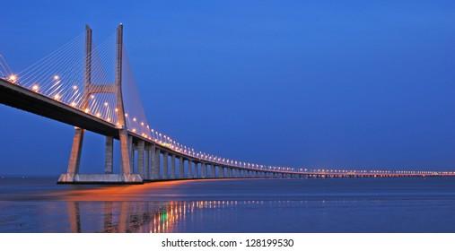night shoot of Vasco da Gama Bridge in Lisbon, Portugal (panoramic picture)