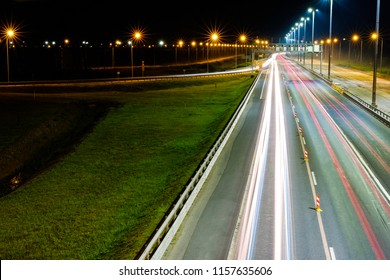 Night shooting road. At night the city lights up. Lighting of the motorway.