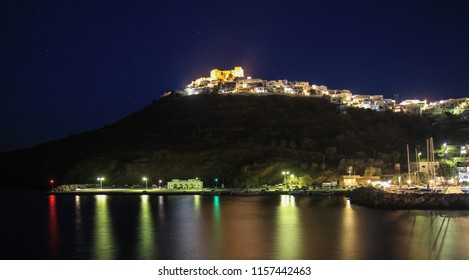 Night shot of the Astypalaia castle and Chora, in Greece. Shot from the old port during August time.