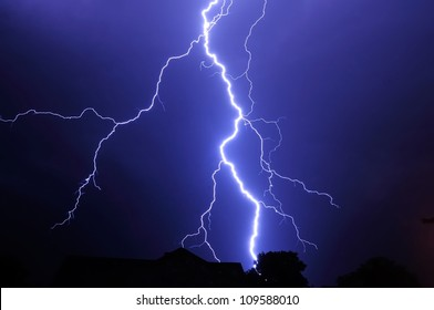 Night shot with big thunderstorm at the starry sky.