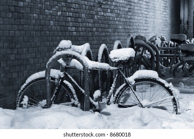 Night shot of a bike under a thick layer of snow