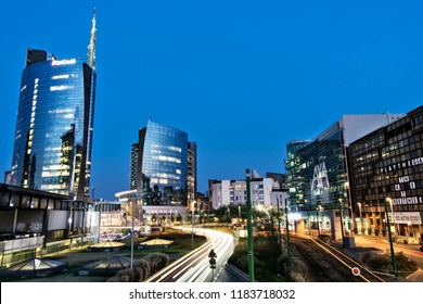 A night shot at blue hour of Unicredit tower skyscraper in Milan downtown, with traffic lights in movement. Italy-Milan 01 September 2018