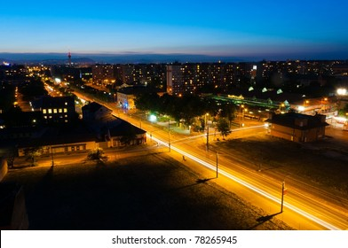 Night shot of a busy city with apartments and lights