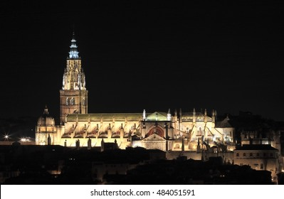 Night shot of Cathedral de Toledo, Castilla La Mancha, Spain, illuminated building next to the River Tagus,