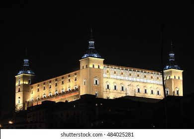 Night shot of Alcázar de Toledo, Castilla La Mancha, Spain, illuminated building next to the River Tagus,