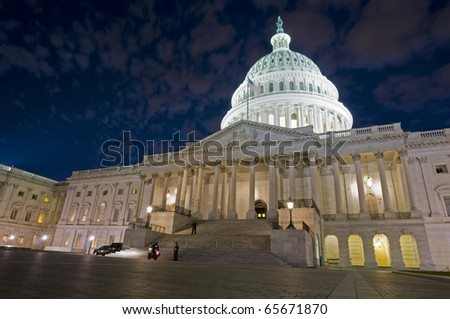 A night shot of the eastern facade and dome of the US Capitol in Washington, DC.