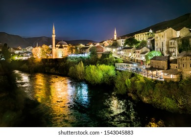 Night Shot from the Famous Old Bridge (Stari Most) Crossing the River Neretva in Mostar, Bosnia and Herzegovina, with the Koski Mehmed Pasha Mosque