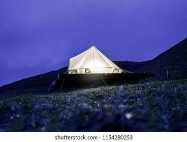 Night shot of a glamping (glamor camping) tent on a mountain.  Long exposure shot.