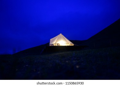 Night shot of a glamping tent on a mountain.  Long exposure shot.