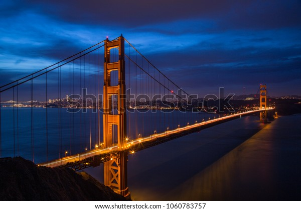Night shot of Golden Gate Bridge with San Francisco in the back