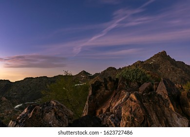 Night shot of hikers' flashlights along Piestewa Peak Trail in the Phoenix, AZ Mountain Preserve
