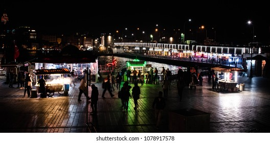 Night shot of Istanbul's touristic Eminonu square, Halic Metro Bridge in background on April 17, 2018