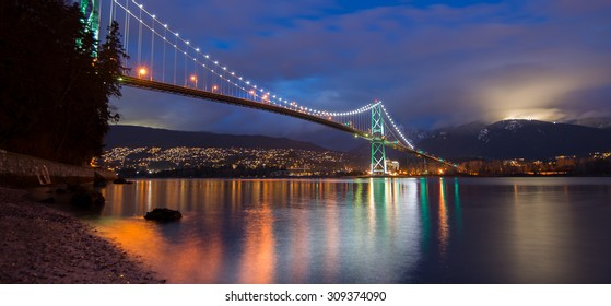 Night shot of Lions gate bridge and grouse mountain