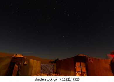 Night shot of a Moroccan Berber camp tents in the african sahara desert