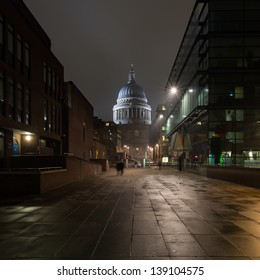Night shot of people walking in a street leading to St Paul's cathedral in London, capital of the united kingdom
