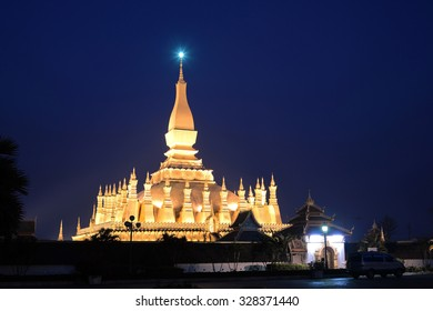 Night shot of Pha That Luang old golden Buddhist pagoda in Vientiane twilight time, Laos. This pagoda was several reconstructions now is one of Laos Landmark and famous place