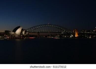 Night shot of Scenic Sydney Harbor and iconic Sydney Opera House and Harbor Bridge Landmarks
