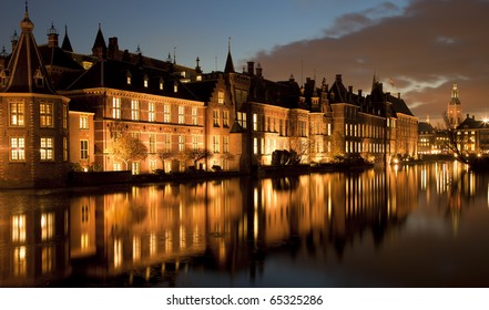 Night shot of the tower of power of Dutch politics, being the historical buildings situated next to a lake, called the Hofvijver, in the center of The Hague, Netherlands