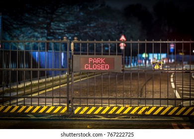 Night sign of park closure, London
