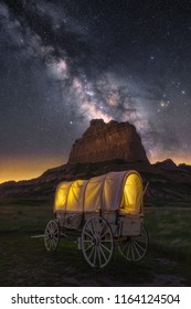 Night skies over old covered wagon, Nebraska