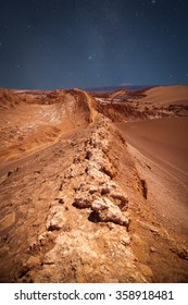 night sky. Amphitheatre is beautiful geological formation of Moon Valley in Atacama Desert, Chile