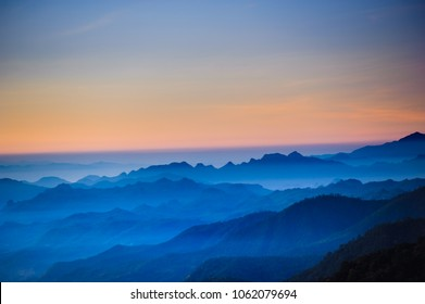 Night sky before sunrise in top of view of beauty blue shade mountain range  in the early morning dawn.