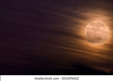 Night Sky With Bright Supermoon Phenomenon With Clouds At Front