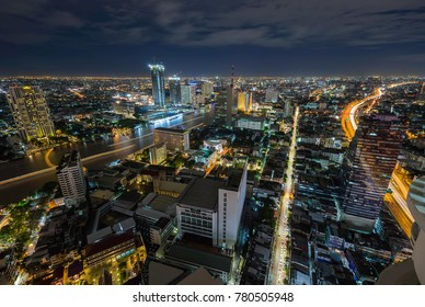 Night sky curve river view of Bangkok cityscape with building